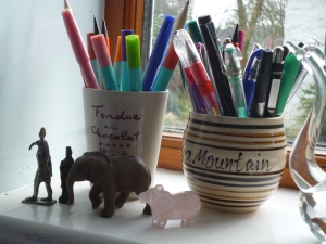 Lots of pens in pots that remind me of heavenly chocolate days!