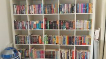 My shelves of MG books, ably guarded by R2D2