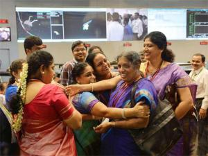 Indian scientists celebrate success of Mars orbiter. Source: AP