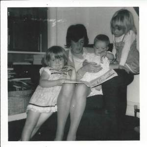 Mum reading to me and my sisters when we were little - I'm on the far right